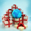 Christmas gift boxes with Africa earth globe surprise at winter snowfall — Stock Photo #35942095