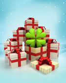 Christmas gift boxes with cloverleaf happy surprise at winter snowfall — Stock Photo