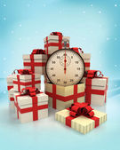 Christmas gift boxes with time surprise at winter snowfall — Stock Photo