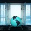 Open doorway with America world globe and winter landscape scene behind — Stock Photo