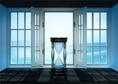 Open doorway with hourglass and winter landscape scene behind — Stock Photo