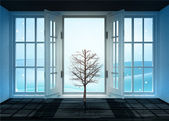 Open doorway with bare tree and winter landscape scene behind — Stockfoto