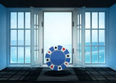 Open doorway with poker chip and winter landscape scene behind — Stockfoto