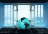 Open doorway with America world globe and winter landscape scene behind — Stockfoto