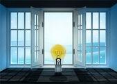 Abra a porta com lâmpada brilhante amarela e cena de paisagem de inverno para trás — Fotografia Stock