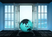 Open doorway with Asia world globe and winter landscape scene behind — Stockfoto