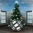 Heavenly room with movie tape gift under glittering xmas tree — Stock Photo
