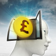 Pound coin investment coming out or in human head with sky background — Stock Photo