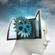 Industrial cogwheel part coming out or in human head with sky background — Stock Photo