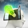Green shining bulb invention coming out or in human head with sky background — Stock Photo #37838591