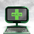 Green metallic computer with health cross with background flare — Stock Photo #37838777