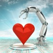 Stock Photo: Industrial cybernetic robotic hand creation of artificial love with cloudy sky