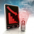 Descending graph with red bulb on phone display with sky — Stock Photo