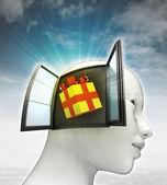 Cadeau verrassing komen uit of in menselijk hoofd met hemelachtergrond — Stockfoto