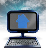 Blue metallic computer with house icon with background flare — Stock Photo