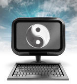 Metallic computer with harmony icon with background flare — Stock Photo