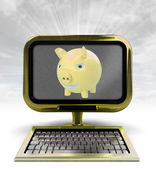 Golden metallic computer with pig with background flare — Stock Photo