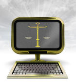 Golden metallic computer with justice weight with background flare — Stock Photo