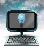 Blue metallic computer with shiny bulb with background flare — Stock Photo