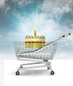 Bought birthday cake in shopping cart with sky — Stock Photo