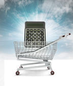 Market calculator in shopping cart with sky — Stock Photo