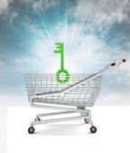 Key to satisfied buy in shopping cart with sky — Stock Photo