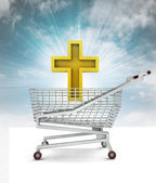 Bought golden cross in shopping cart with sky — Stock Photo