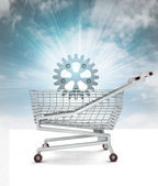 Bought spare part in shopping cart with sky — Stock Photo