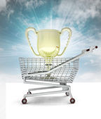 Trade business champion, cup in shopping cart with sky — Stock Photo
