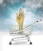 Customer trade hand in shopping cart with sky — Stock Photo