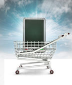Bought new smart phone in shopping cart with sky — Stock Photo