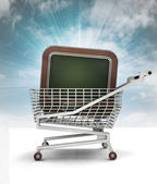 Bought television in shopping cart with sky — Stock Photo