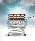 Bought treasure in shopping cart with sky — Stock Photo