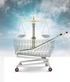 Trade justice in shopping cart with sky — Stock Photo