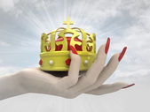 Kings royal crown in women hand render — Stock Photo