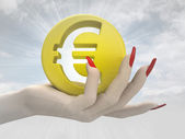 Gold euro coin in women hand render — Stock Photo