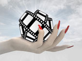 Movie tape in women hand render — Stok fotoğraf