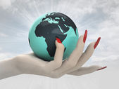 Globe with north Africa in women hand render — Stock Photo