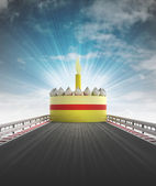 Cake on motorway leading to celebration with sky flare — Stock Photo