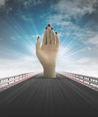 Human hand on motorway track stops traffic with sky flare — Stock Photo