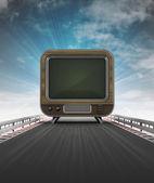 Televisie op snelweg spoor leidt tot entertainment met sky flare — Stockfoto