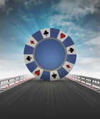 Poker chip on motorway track leading to casino with sky flare — Stock Photo