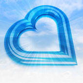 Blue heart shape in sky flare view — Zdjęcie stockowe