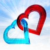 Red and blue glassy heart together in sky flare — Stock Photo