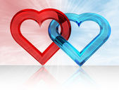 Red and blue glassy hearts — Stock Photo