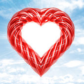 Red glassy tube shaped heart in sky flare — Stock Photo