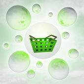 Green shopping basket with glossy bubbles in the air with flare — Stock Photo