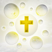 Christian golden cross with glossy bubbles in the air with flare — Stock Photo