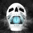 Human skull with stopwatch in jaws — Stock Photo #42649455