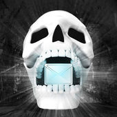 Human skull with mail sign in jaws — Stock Photo